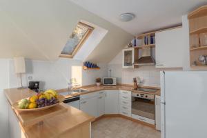 Kuhinja oz. manjša kuhinja v nastanitvi Fine Stay Apartments