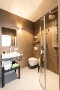 Een badkamer bij Boutique Hotel Goud En Zilver