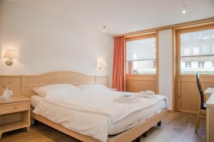 A bed or beds in a room at Apartment Stotzhalten 3.5 - GriwaRent AG