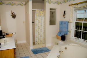A bathroom at Brightwood Inn
