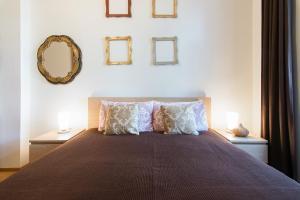 Postel nebo postele na pokoji v ubytování Prague Getaway Homes Slavojova