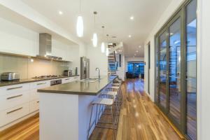 A kitchen or kitchenette at Ocean View: Luxury Beachfront