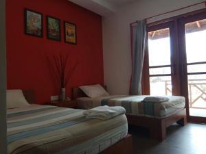 Ein Bett oder Betten in einem Zimmer der Unterkunft Bagan Nova