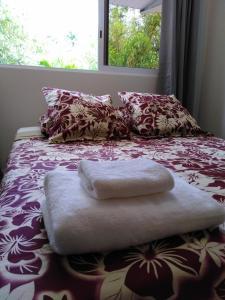 Cama ou camas em um quarto em Fare Manava