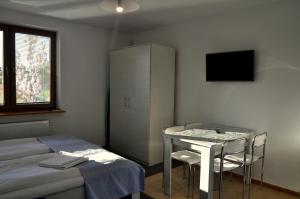 Łóżko lub łóżka w pokoju w obiekcie Gościniec Kaszubski Homestay