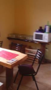 Un restaurant u otro lugar para comer en Los Milenarios