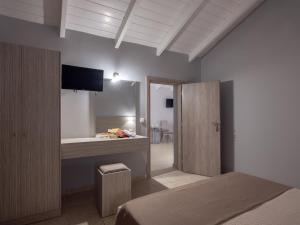 A bed or beds in a room at Zante Atlantis Hotel