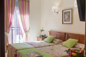 Cama o camas de una habitación en Hostal Antigua Morellana