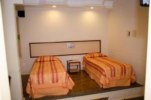 A bed or beds in a room at Primum Palace Hotel