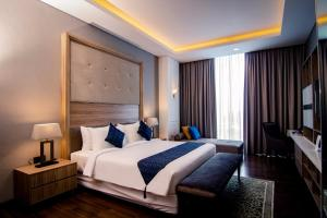 A bed or beds in a room at PSW Antasari Hotel