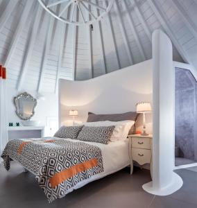 A bed or beds in a room at Absolute Mykonos Suites & More
