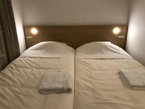 A bed or beds in a room at Sapporo Oriental Hotel