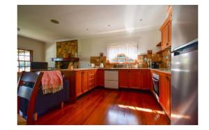 A kitchen or kitchenette at Lakefront holiday villa