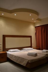 A bed or beds in a room at Panorama Hotel Apartments