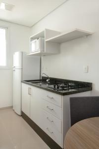 A kitchen or kitchenette at Space Residence