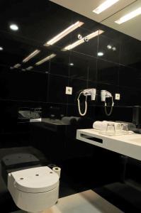A bathroom at Open Village Sports Hotel & Spa Club