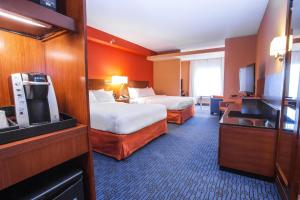 A bed or beds in a room at Fairfield Inn & Suites by Marriott St. John's Newfoundland