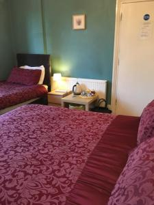 A bed or beds in a room at The Townhouse B and B