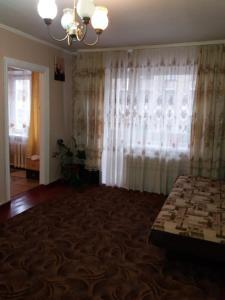 Кровать или кровати в номере Апартаменты на Советском 34
