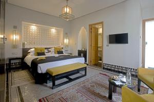Кровать или кровати в номере Palais Amani
