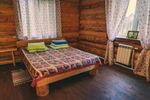 """A bed or beds in a room at Holiday home """"Emelya"""""""