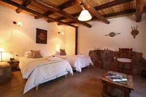 A bed or beds in a room at Posada Con Los Ángeles