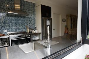 A kitchen or kitchenette at Chevignon