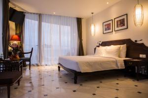 Кровать или кровати в номере The Palmy Phu Quoc Resort & Spa
