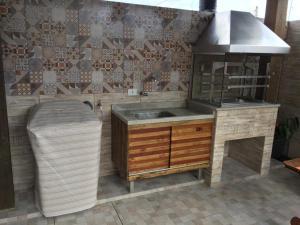 A cozinha ou cozinha compacta de Casa João de Barro
