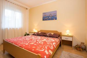 A bed or beds in a room at Apartments Kraljic