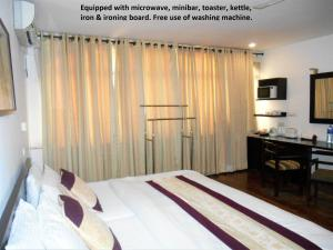 A bed or beds in a room at 7HCR Residencies 2 bed studio 2-1 in Colombo 2