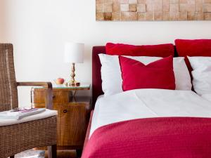 Een bed of bedden in een kamer bij Boutiquehotel Stadthalle