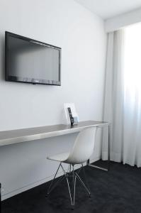 A television and/or entertainment center at Open Village Sports Hotel & Spa Club