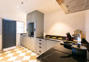 A kitchen or kitchenette at THEA Serviced Apartment by TH District