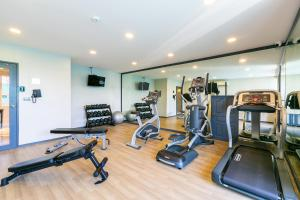 The fitness center and/or fitness facilities at THEA Serviced Apartment by TH District