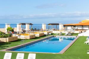 The swimming pool at or near Villa De Adeje Beach