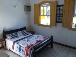 A bed or beds in a room at Pousada Fortaleza