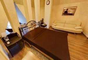 Кровать или кровати в номере Koleso Hotel