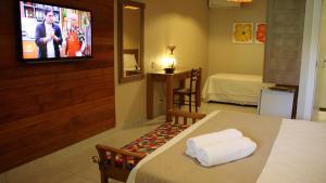 Cama ou camas em um quarto em Pousada Porto e Mar