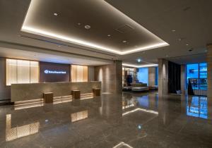 The lobby or reception area at Daiwa Roynet Hotel Himeji