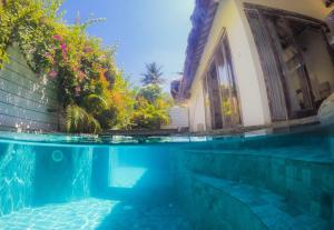 The swimming pool at or near Atoll Haven Villas