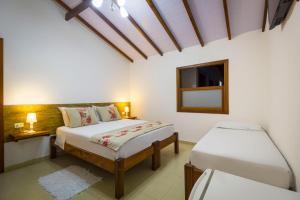 A bed or beds in a room at Pousada Vila do Porto
