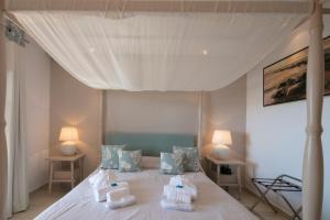 Letto o letti in una camera di Magic Hotel