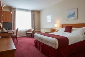 A bed or beds in a room at Future Inn Plymouth