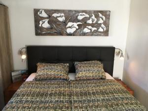 Un ou plusieurs lits dans un hébergement de l'établissement Nicolette Apartments