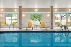 The swimming pool at or near Fairfield Inn & Suites Lansing West