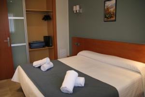 Cama o camas de una habitación en Suites Independencia - Abapart
