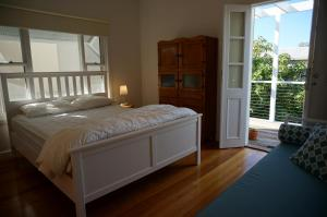 A bed or beds in a room at Cooinda