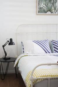 A bed or beds in a room at Island Cottages