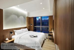 A bed or beds in a room at The OTTO Hotel